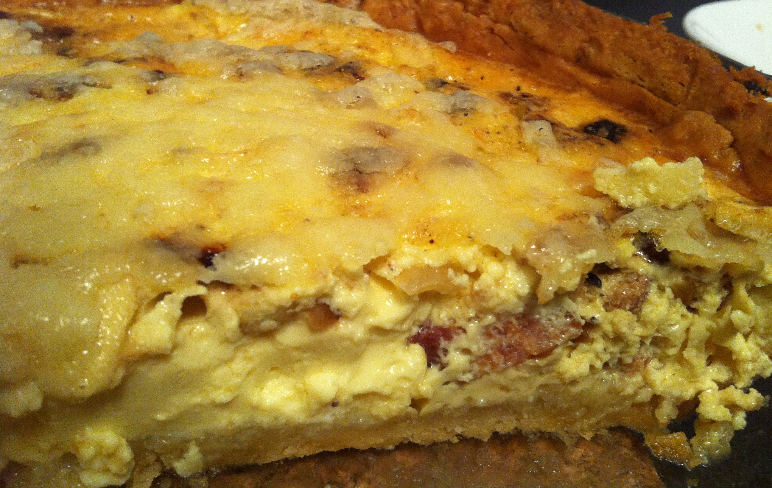 Quiche with crispy bacon, caramelized onions, green apples, and sharp cheddar cheese