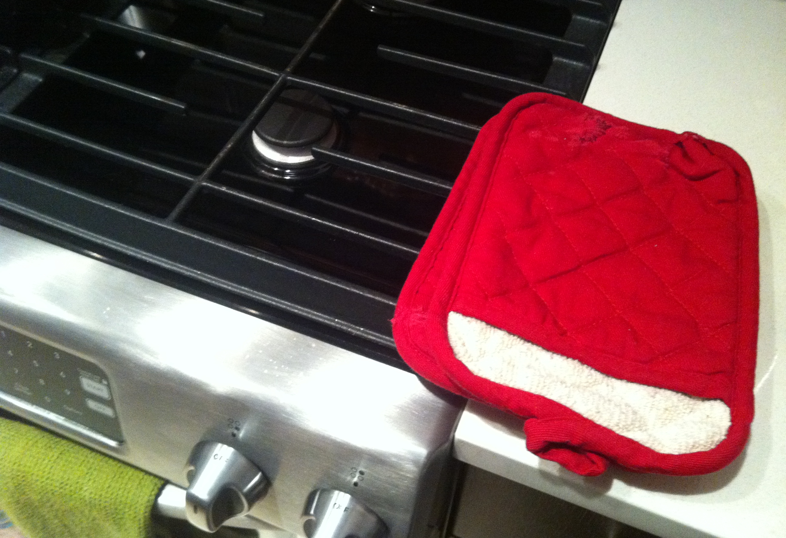 Potholders right next to the stove; okay, they're normally a few inches to the right of where they are here